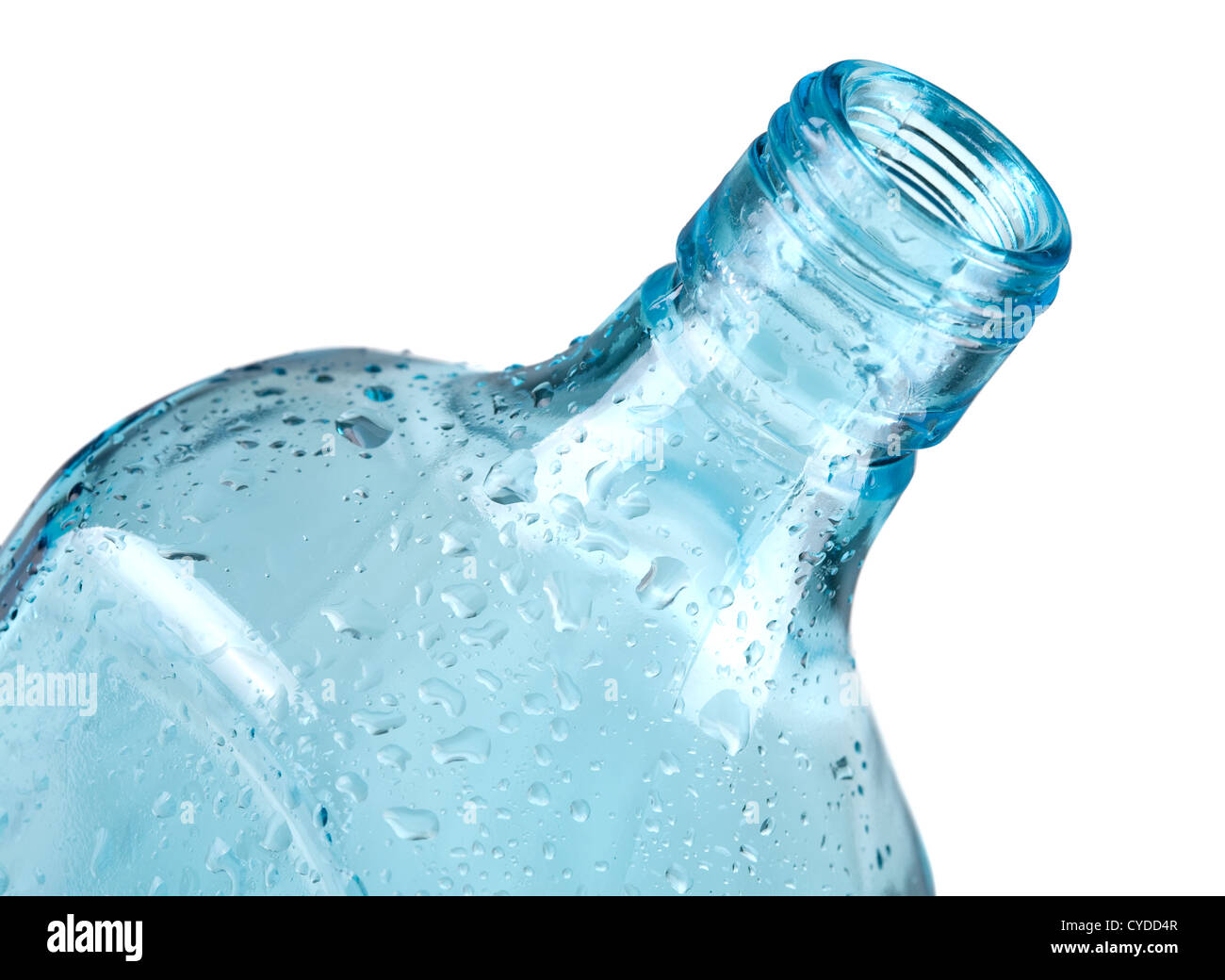 Blue empty bottle with water drops. Closeup, isolated on white Stock Photo