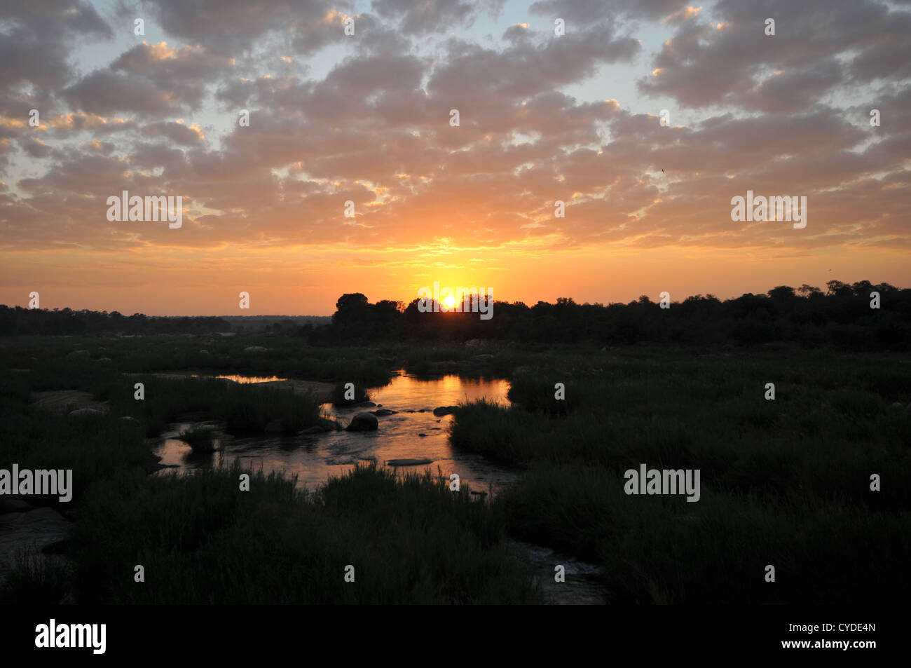 Sunrise at Kruger Park by Kruger Gate in South Africa. View into the sun over the water. - Stock Image