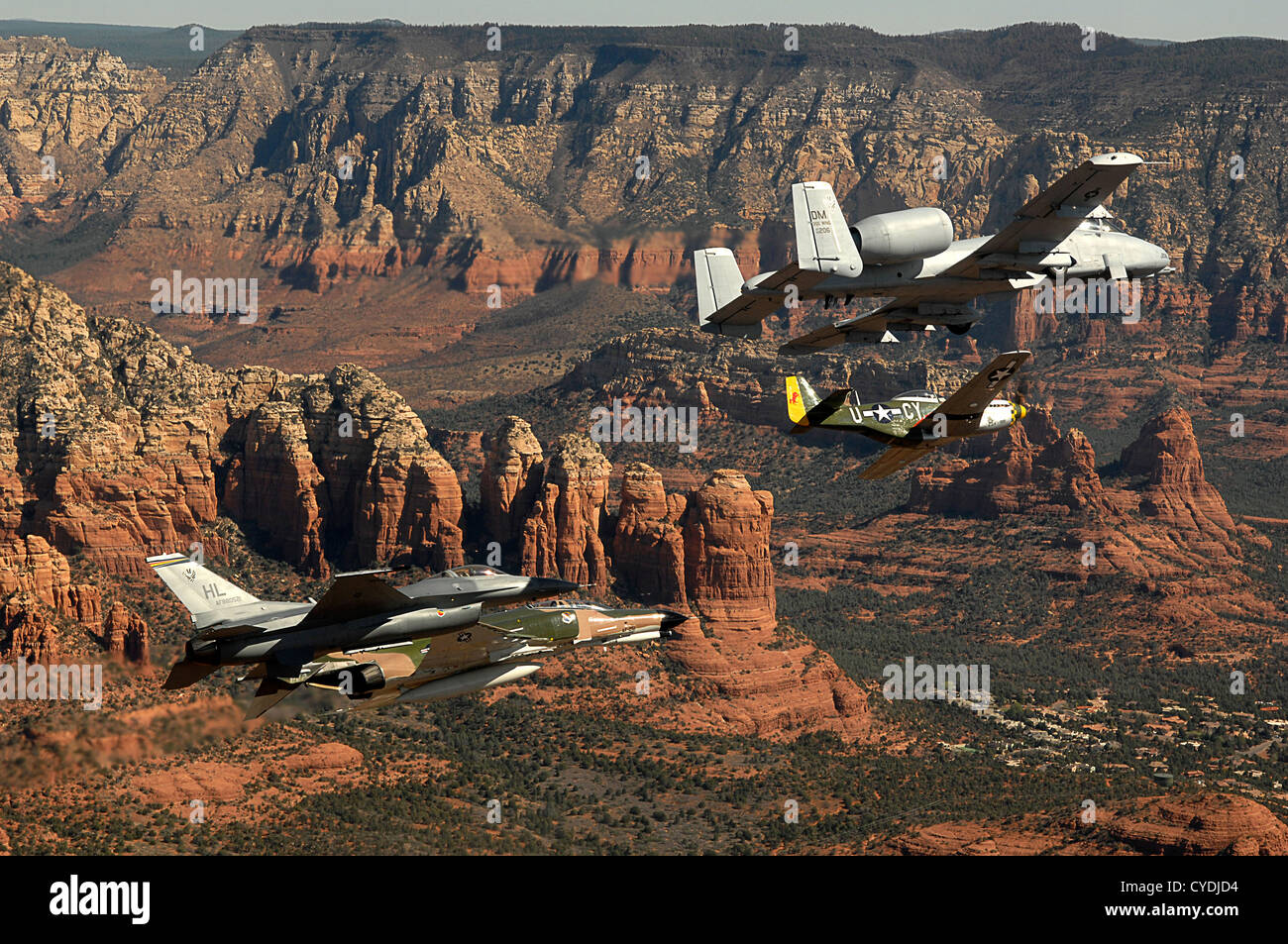 An Air Force heritage flight consisting of a P-51 Mustang, an F-4 Phantom, an A-10 Thunderbolt and an F-16 Fighting - Stock Image