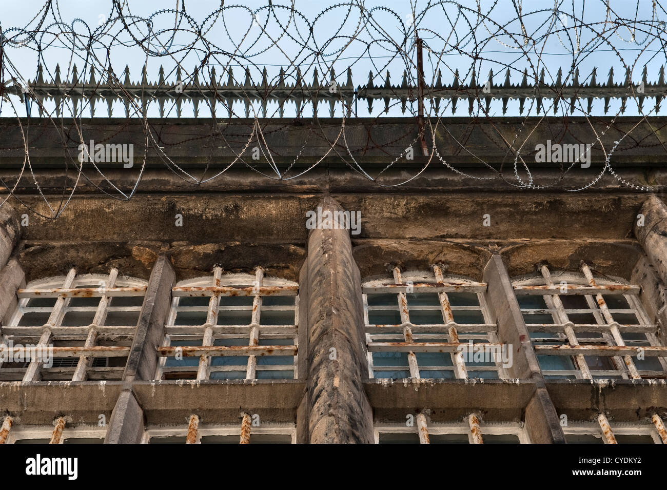 Bars and wire guard cells in a recently abandoned prison in the UK - Stock Image