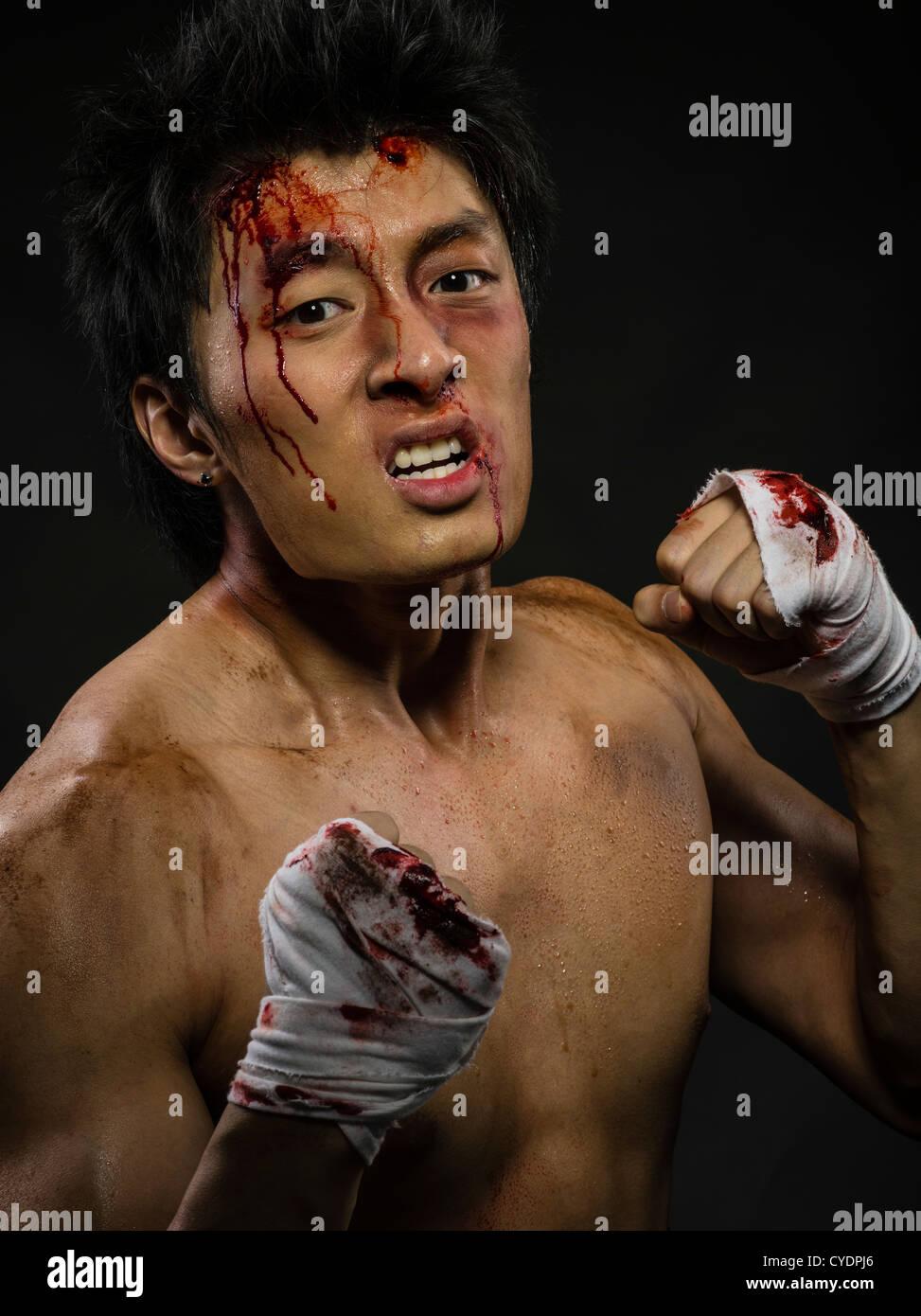 Street fighter  / bare-knuckle brawler - Stock Image