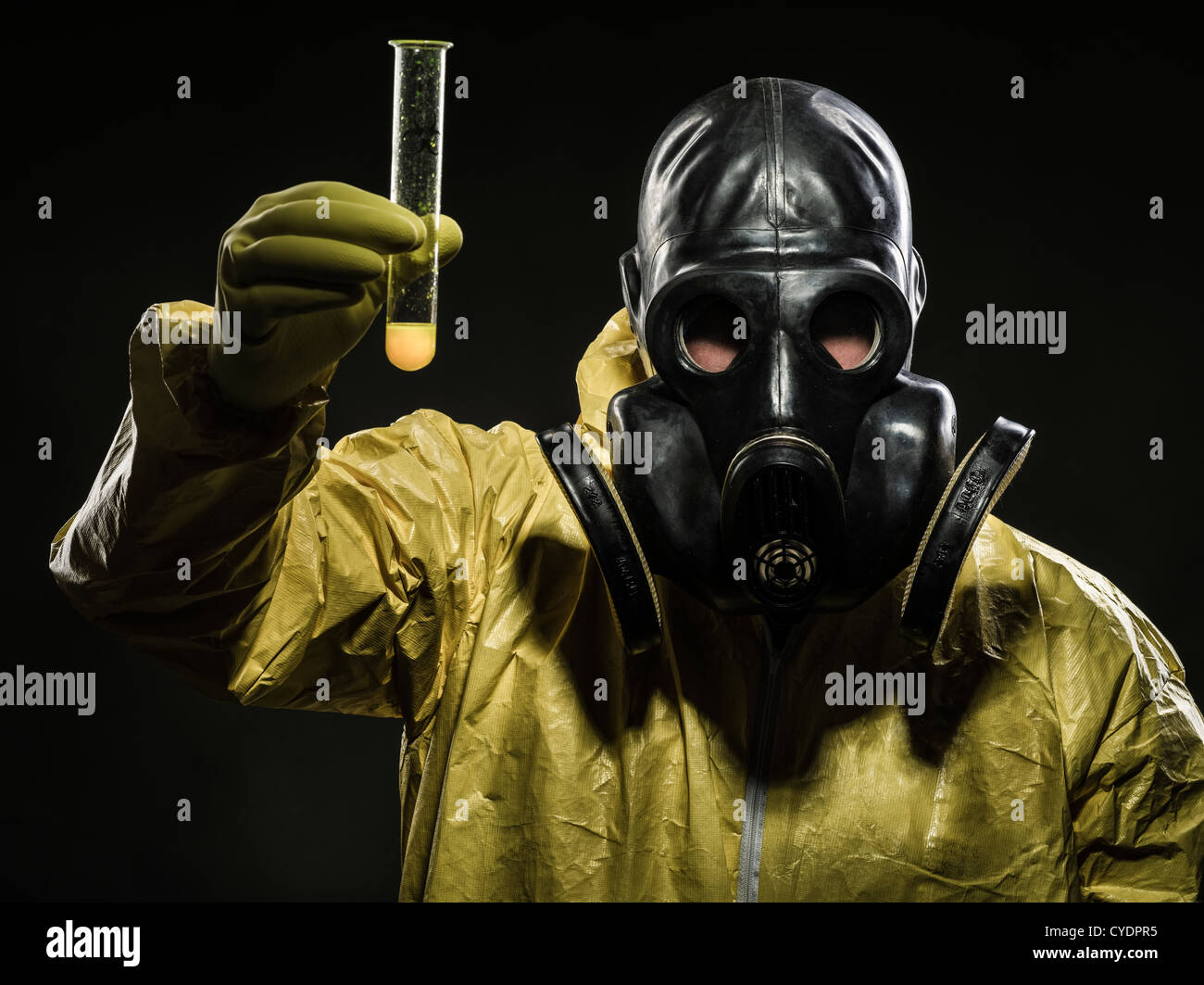 Man with gas mask and hazmat suit - Stock Image