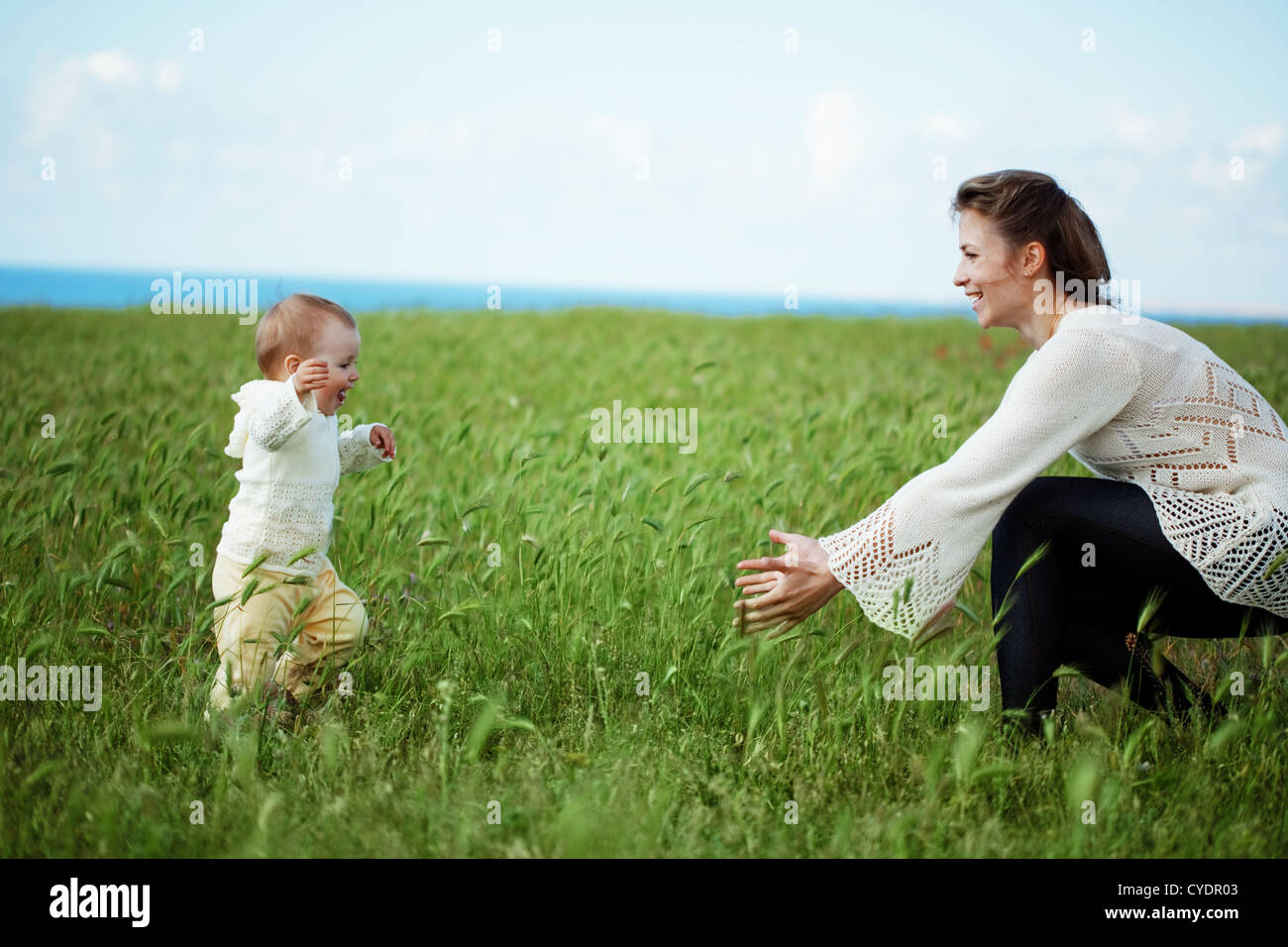 Female Toddler Running In Field Stock Photos   Female Toddler ... fb65bd18c527