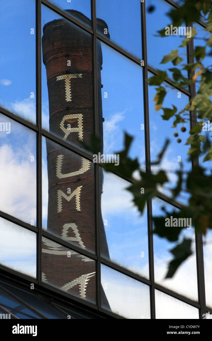 Chimney of the former Truman Brewery in reflection, Brick Lane, London Stock Photo