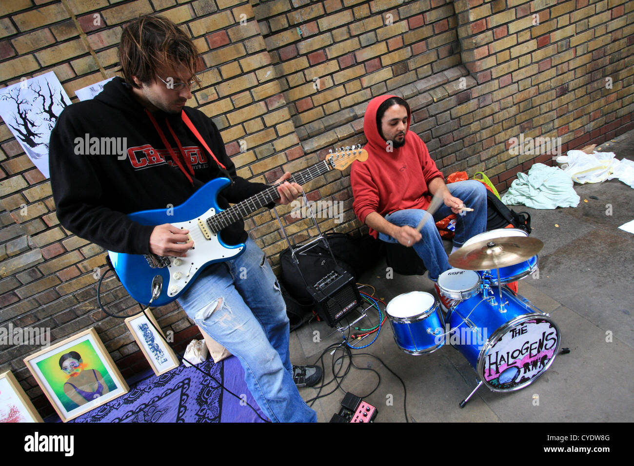 Buskers playing on a street, Brick Lane, London Stock Photo