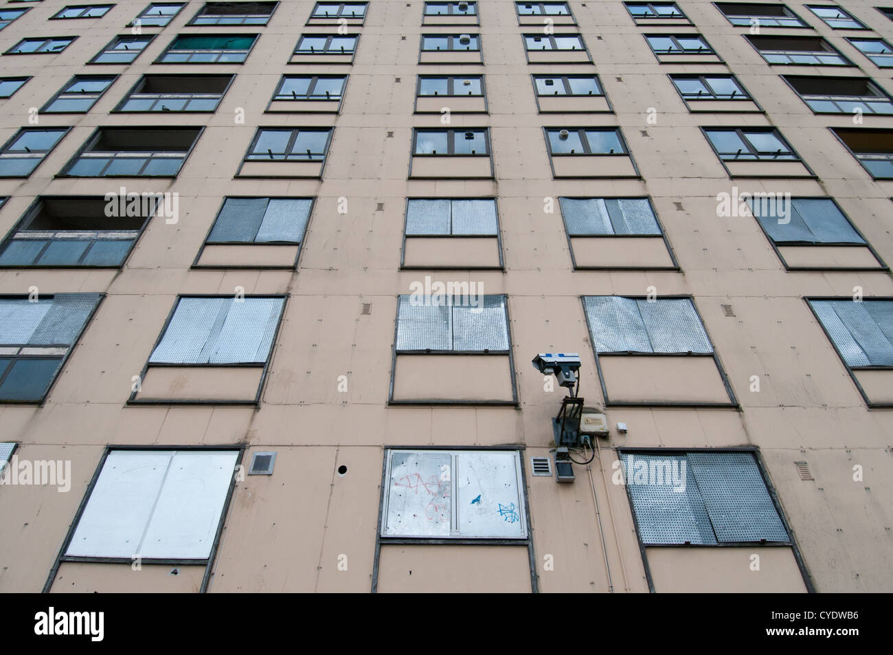 Surveillance, CCTV or closed circuit video camera mounted on the wall of Glasgow's notorious Red Road Flats, - Stock Image