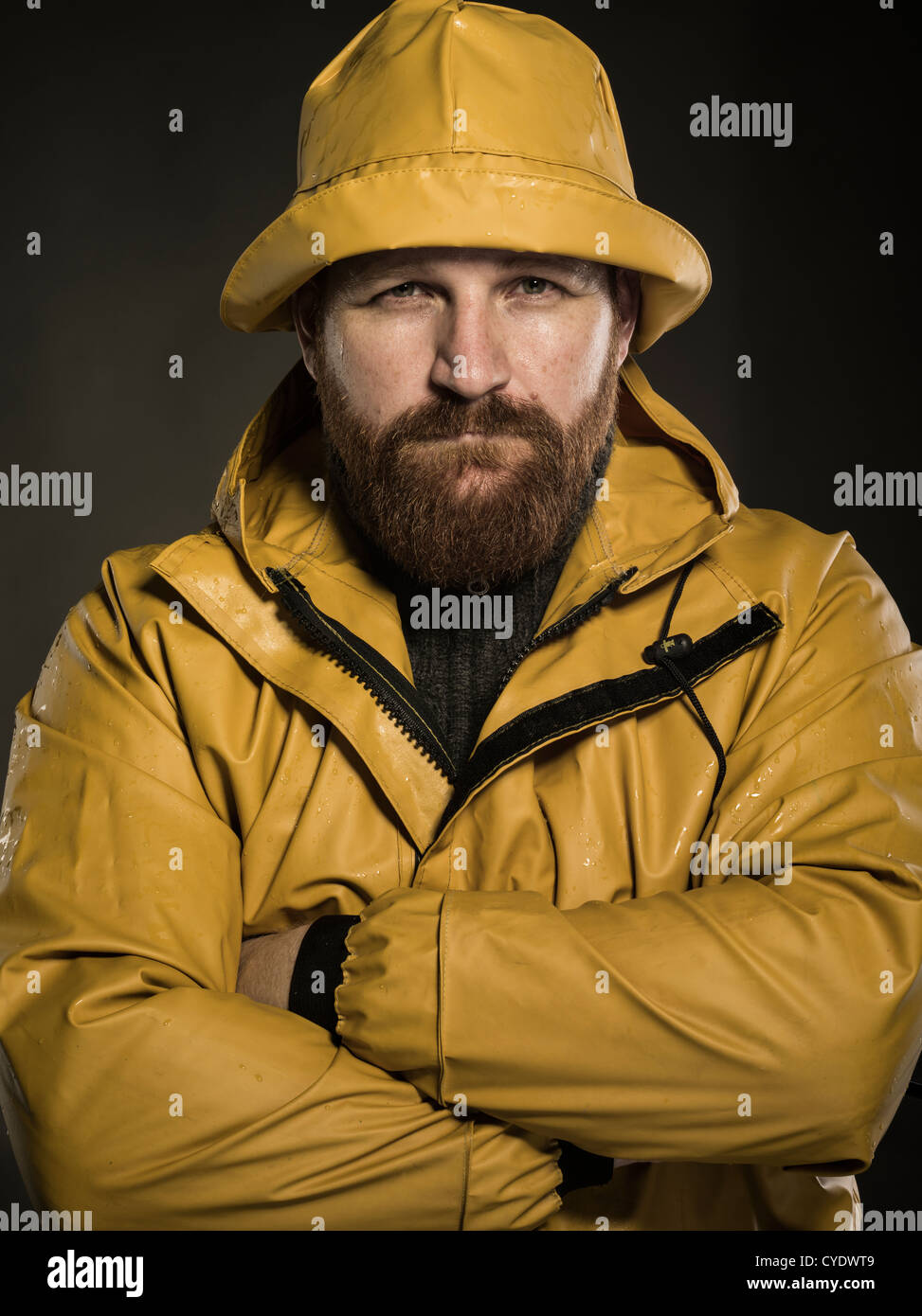 5d289fd4317 fisherman wearing yellow sou wester oilskin - Stock Image