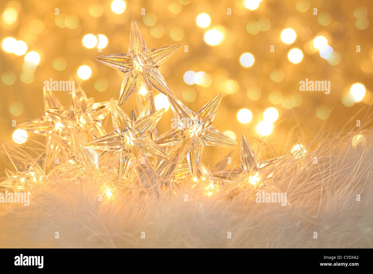 Star holiday lights with gold sparkle background - Stock Image