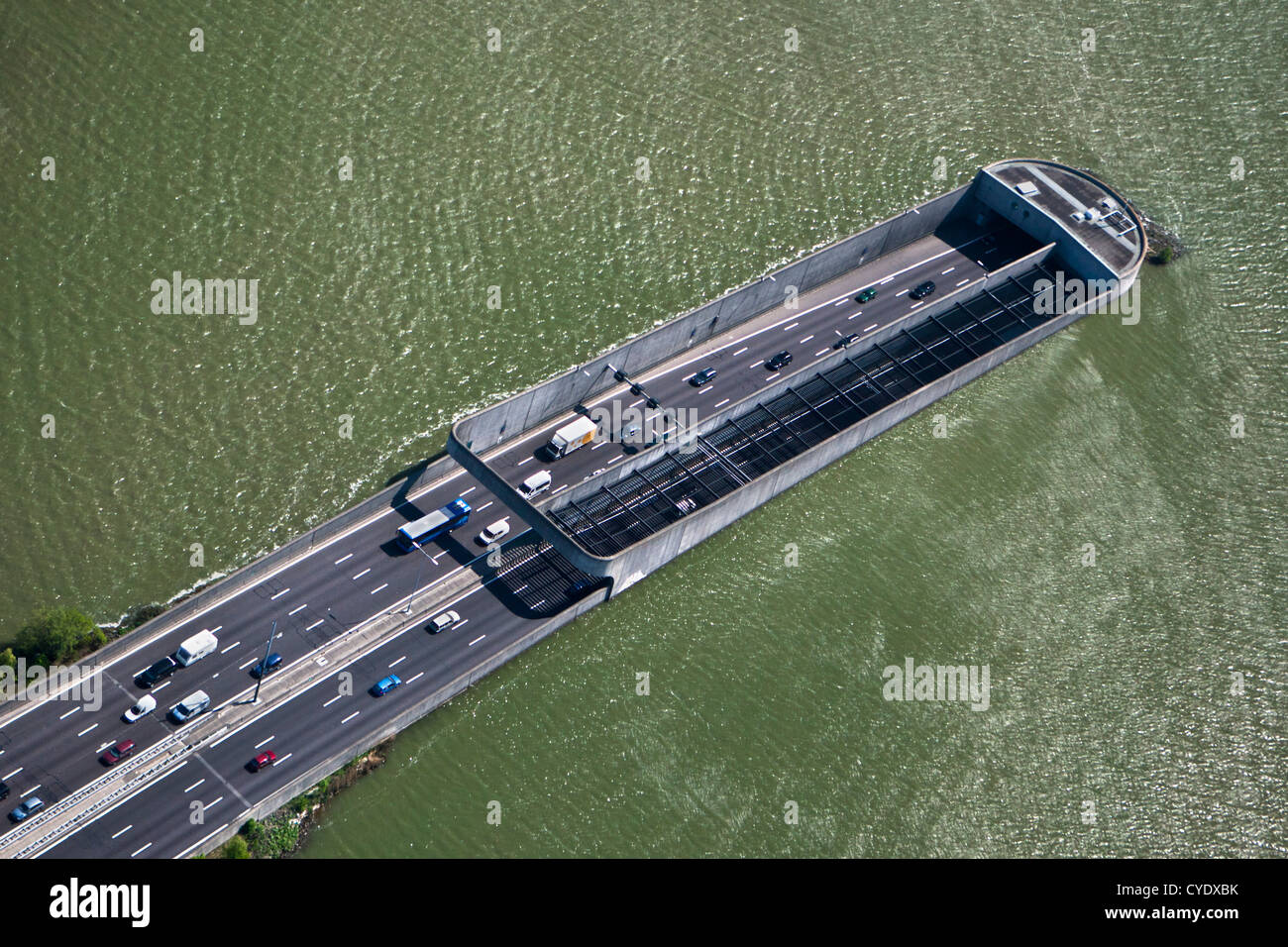 The Netherlands, Amsterdam, Access of Zeeburgertunnel, connecting the south and north of the city. Lake Het IJ. - Stock Image