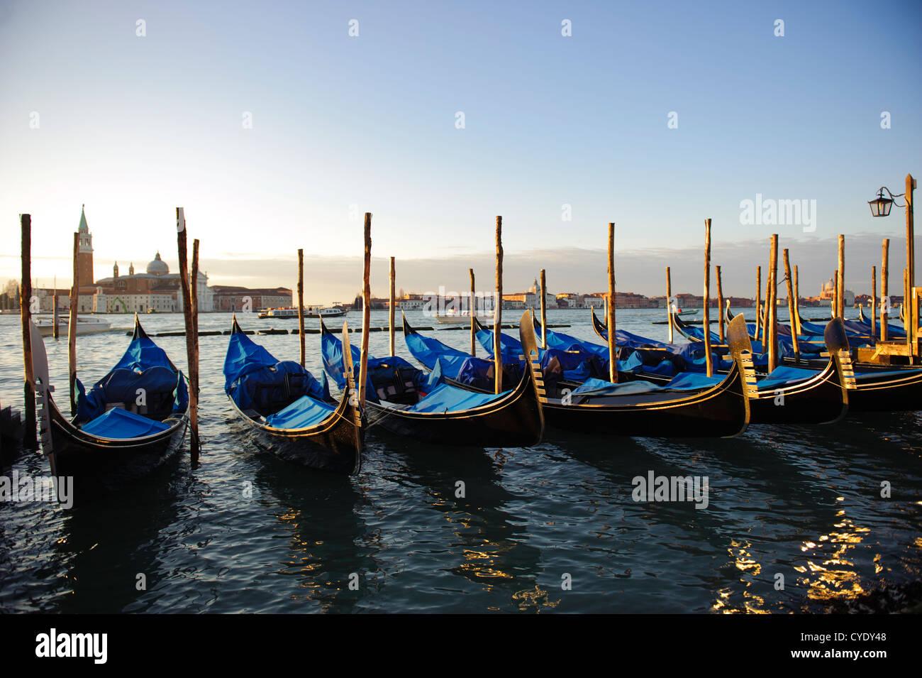 Gondolas moored in front of the Basilica of San Giorgio Maggiore, Venice, Veneto, Italy. Stock Photo