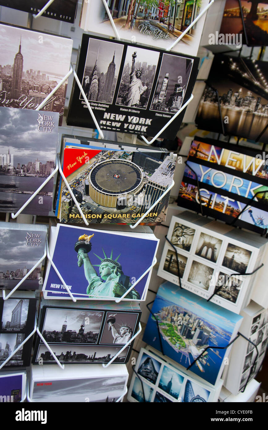 postcards on stand outside gift shop in Manhattan, New York - Stock Image