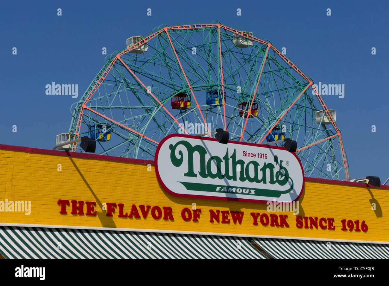 Wonder wheel in Astroland amusement park on Coney Island,with Nathans famous hot dog restaurant New York,New York,United - Stock Image