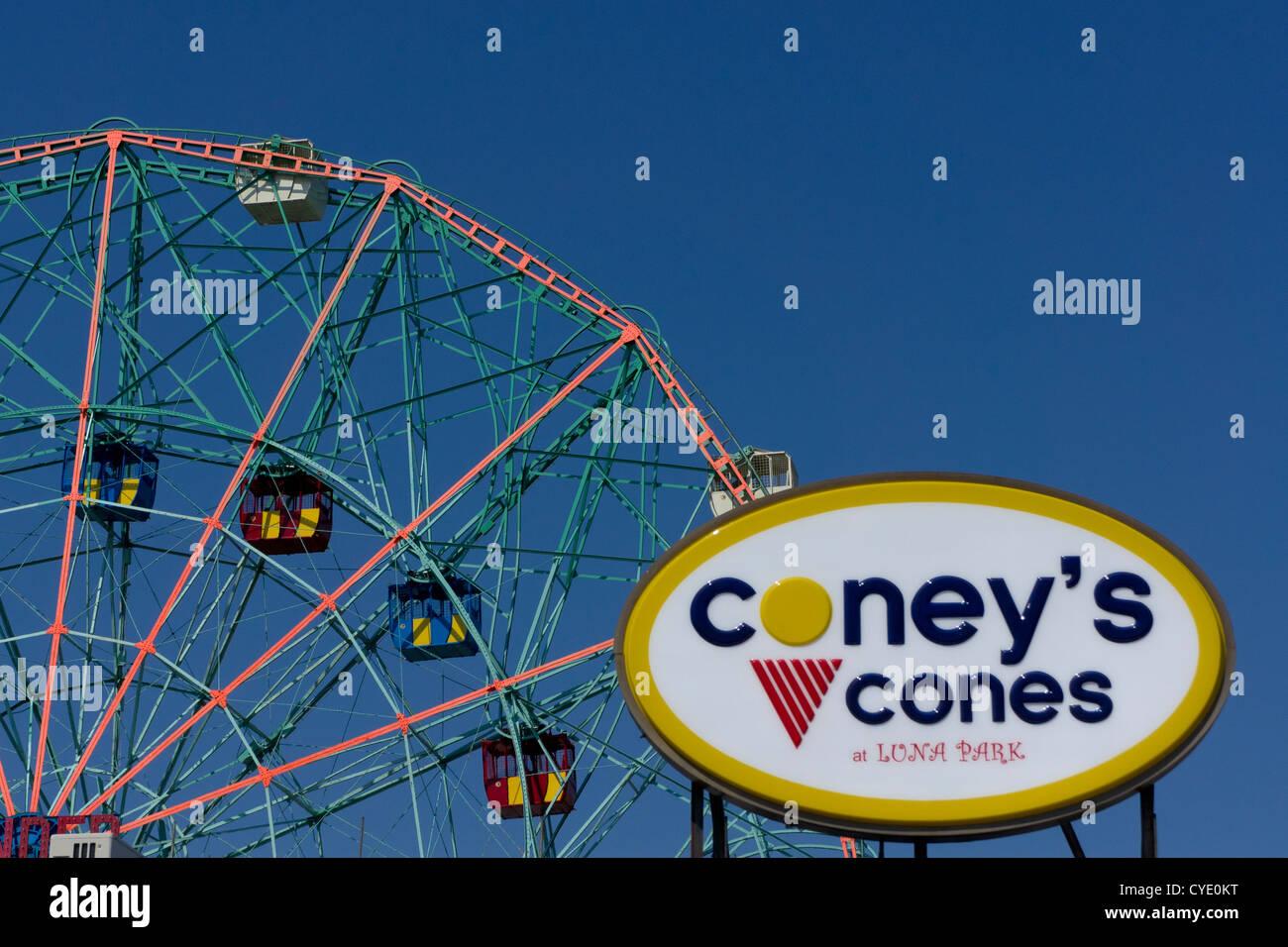 Wonder wheel in Astroland amusement park on Coney Island, with boardwalk ice cream shop sign, New York, New York, - Stock Image