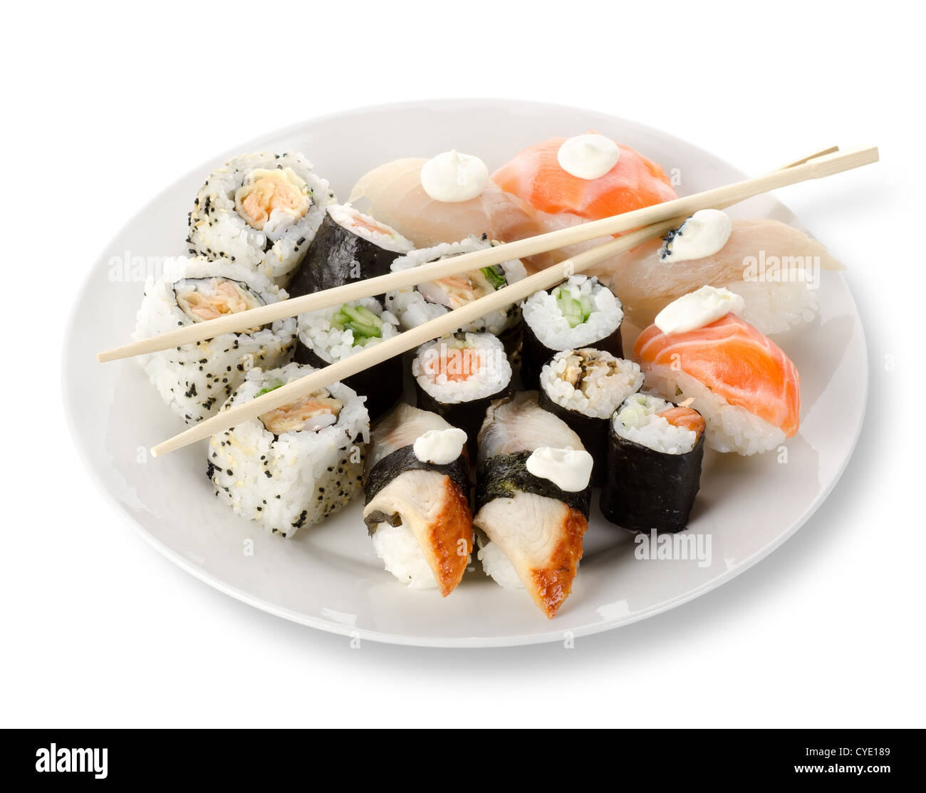 Sushi and rolls in a plate with sticks isolated on a white background. Clipping path - Stock Image