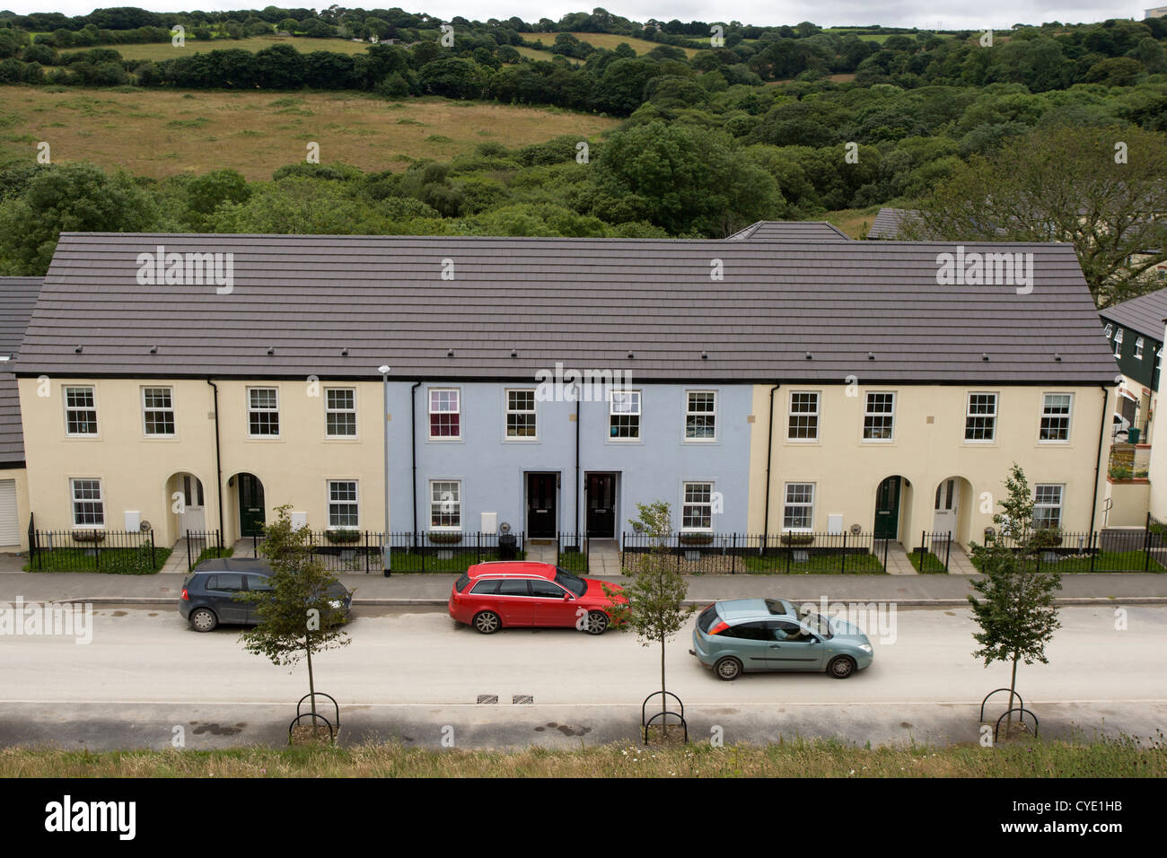 A row of modern terraced houses built on the edge of Truro city with countryside beyond. - Stock Image
