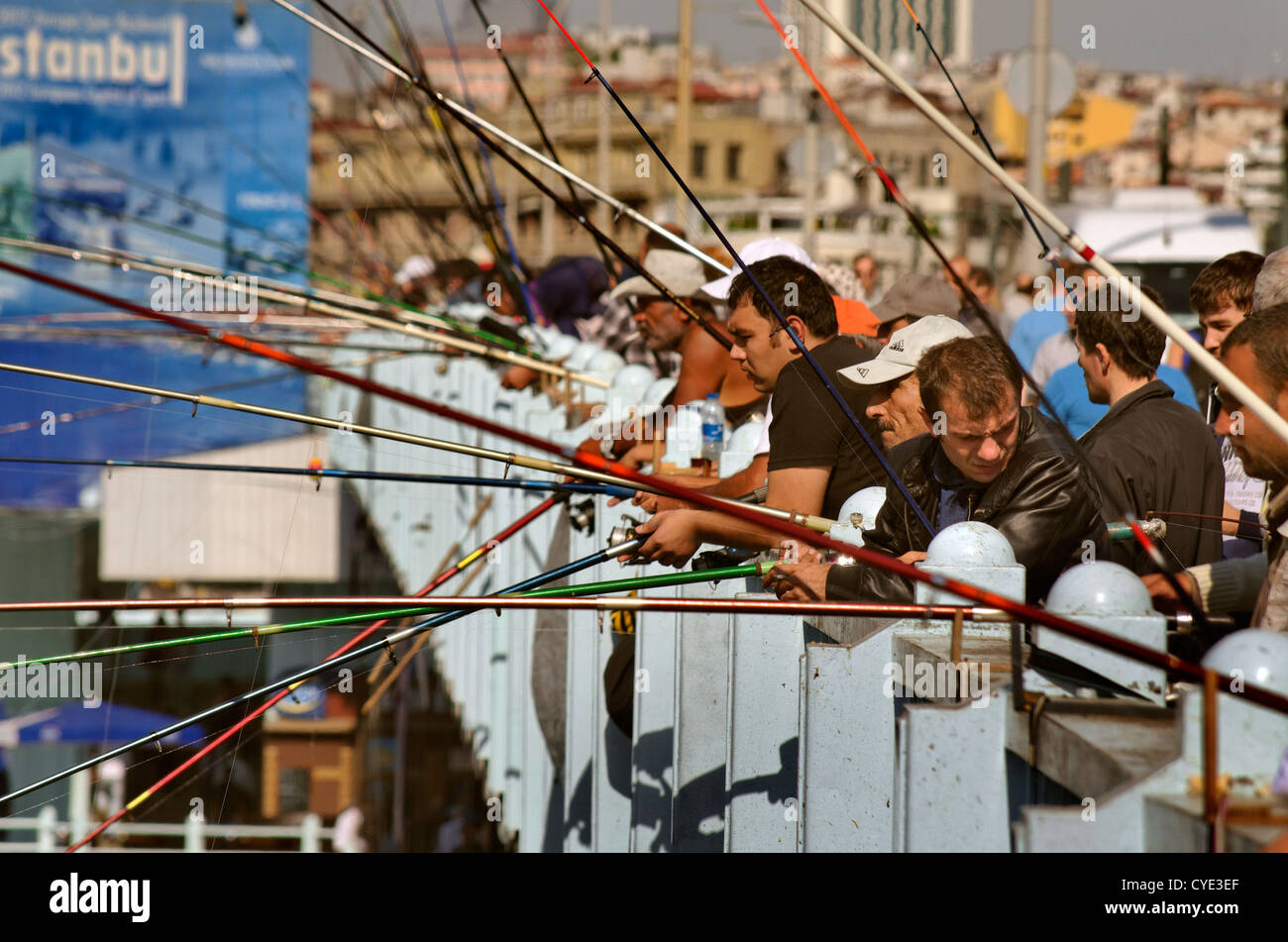 Fishermen of the Galata Bridge, Golden Horn, Istanbul, Turkey - Stock Image