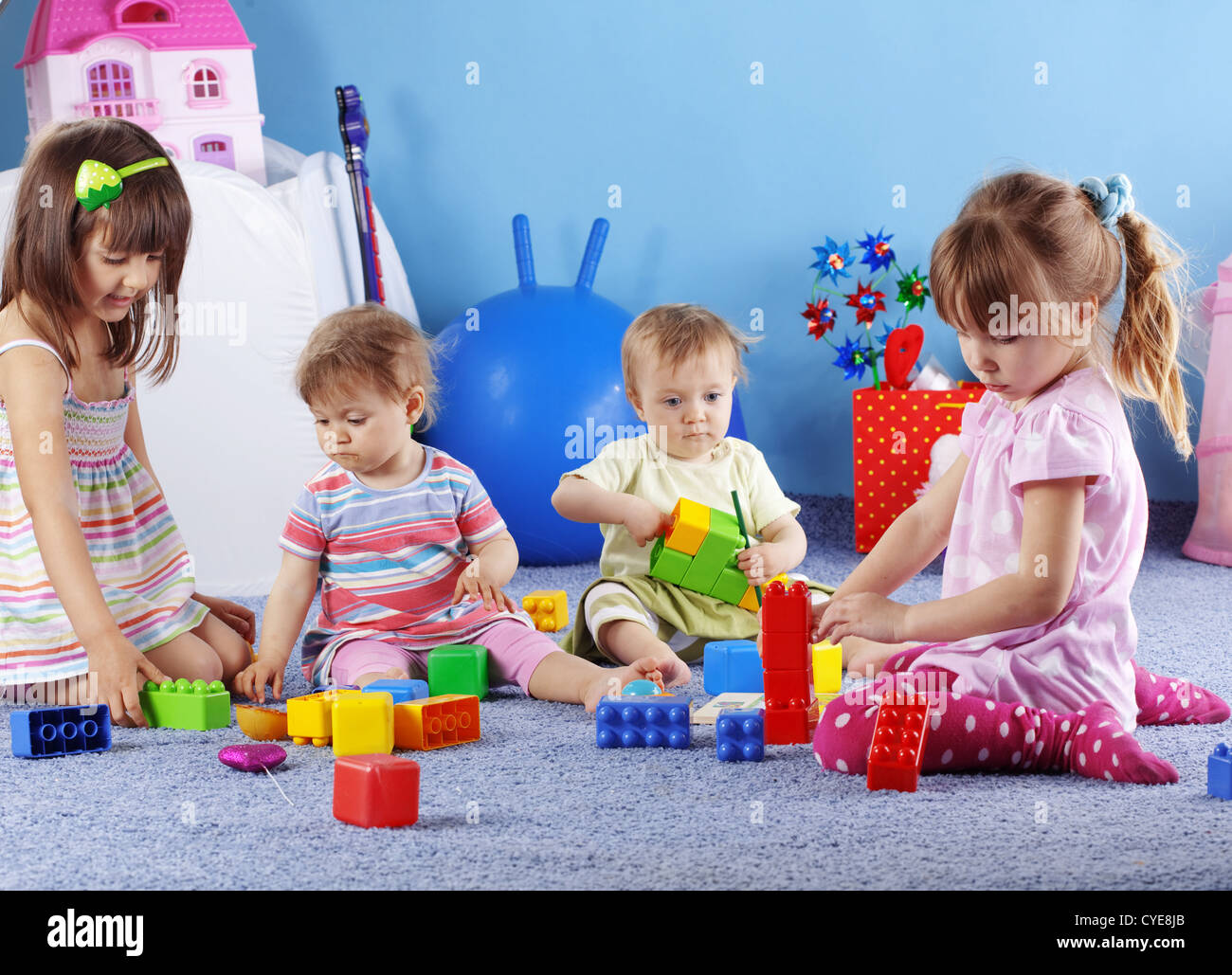 Group of kids playing with constructor - Stock Image