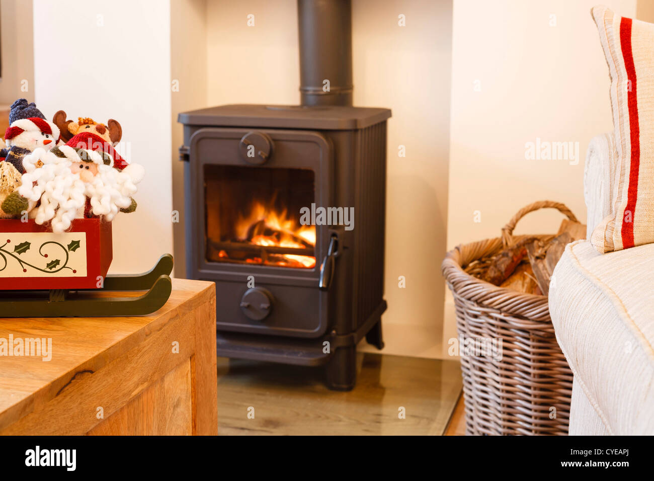 Wood burning stove and christmas ornaments in a modern living room Stock Photo