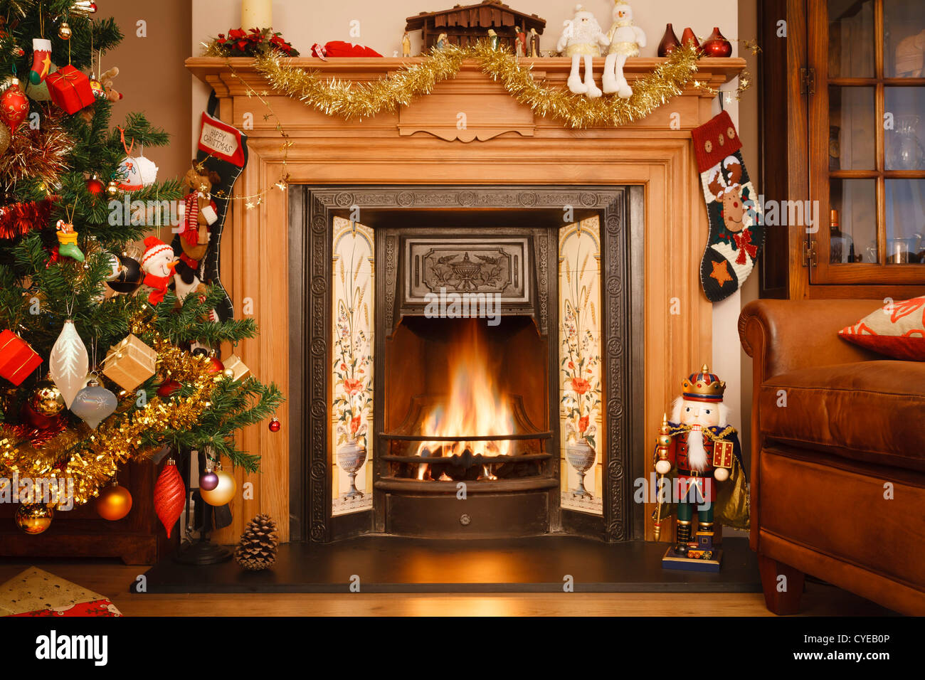 Christmas fire place in a living room - Stock Image