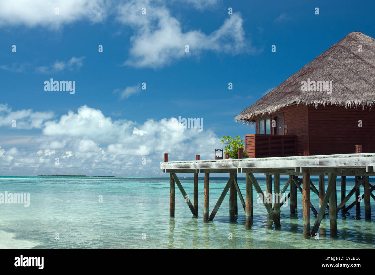 Overwater bungalow in beautiful blue lagoon Maldives