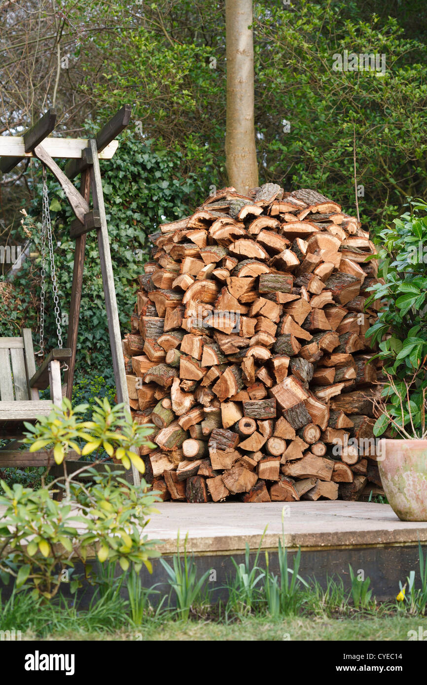 Circular wood stack or holz hausen with oak firewood seasoning in a ...