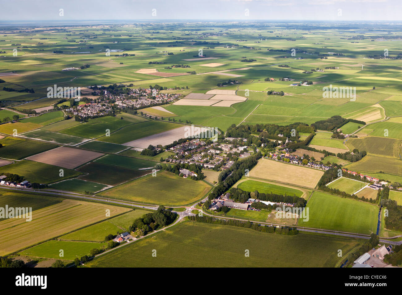 The Netherlands, near Stiens, Villages and farmland. Aerial. - Stock Image