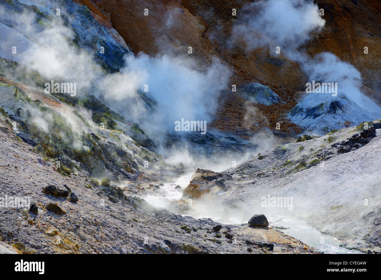 Steam rises from Jigokudani (Hell Valley) in Noboribetsu, Hokkaido. - Stock Image
