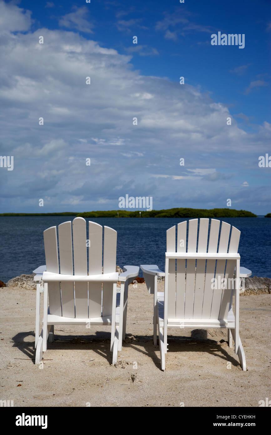 two empty sun loungers on private beach islamorada florida keys usa - Stock Image