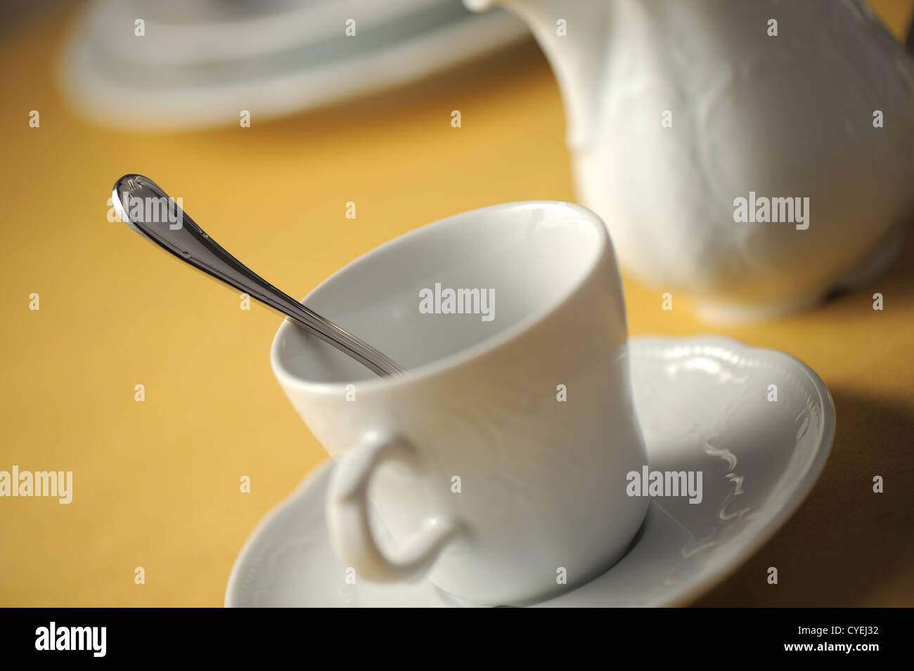 cup on table, close up, shallow dof - Stock Image