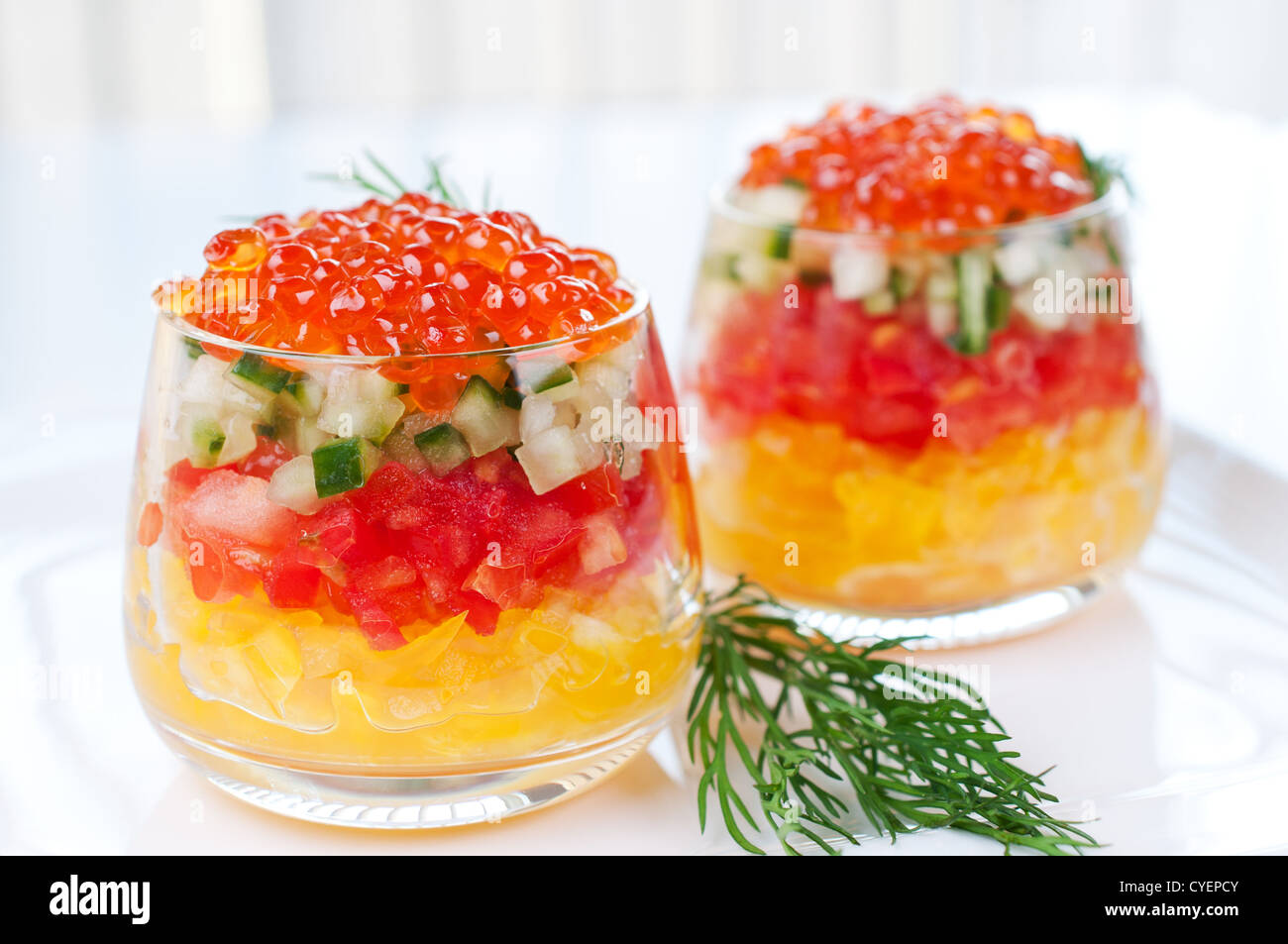 Caviar with vegetable salad decorated sprig of dill on plate - Stock Image