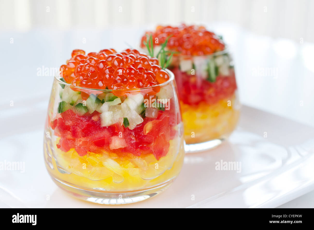 Caviar with vegetable salad in glasses - Stock Image