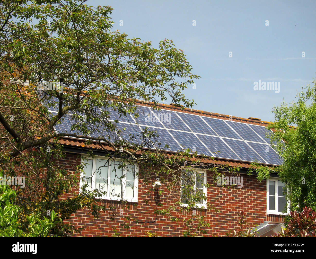 Typical English house with a set of solar panels, May 2012 - Stock Image