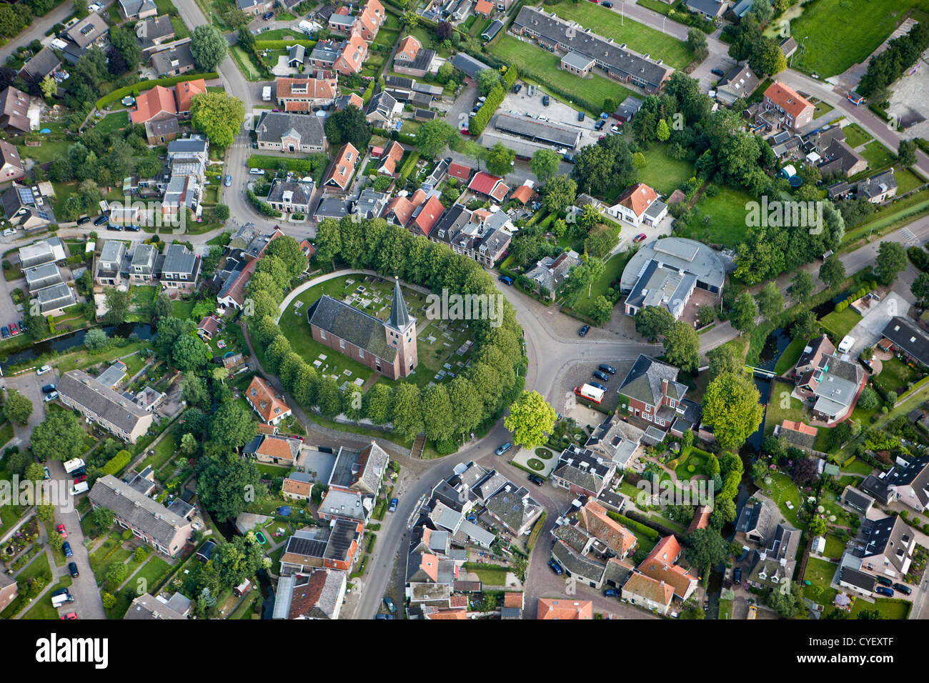 The Netherlands, Raerd, Aerial. Center of village with church on mount. Stock Photo