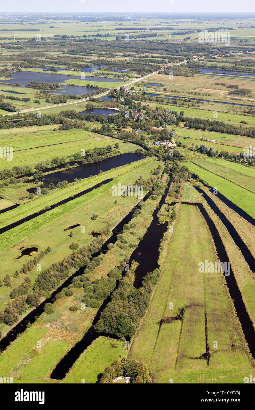The Netherlands, Nijetrijne, Nature reserve called Rottige Meente and farmland. Small boats in marina. Aerial. - Stock Image