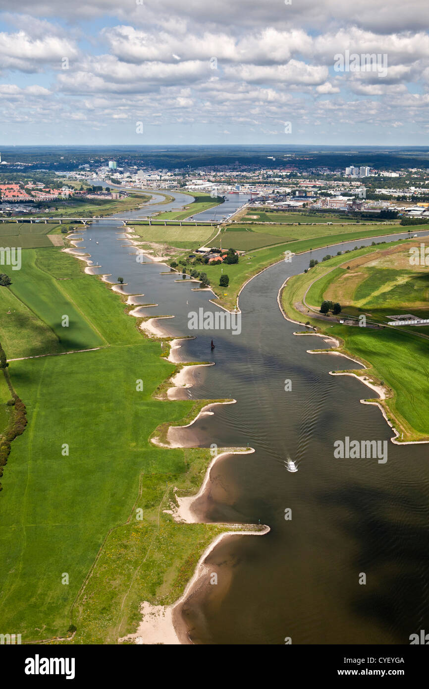 The Netherlands, Pannerden, Bifurcation of Rhine river into Waal river (left) and Rhine river (right). Aerial. - Stock Image