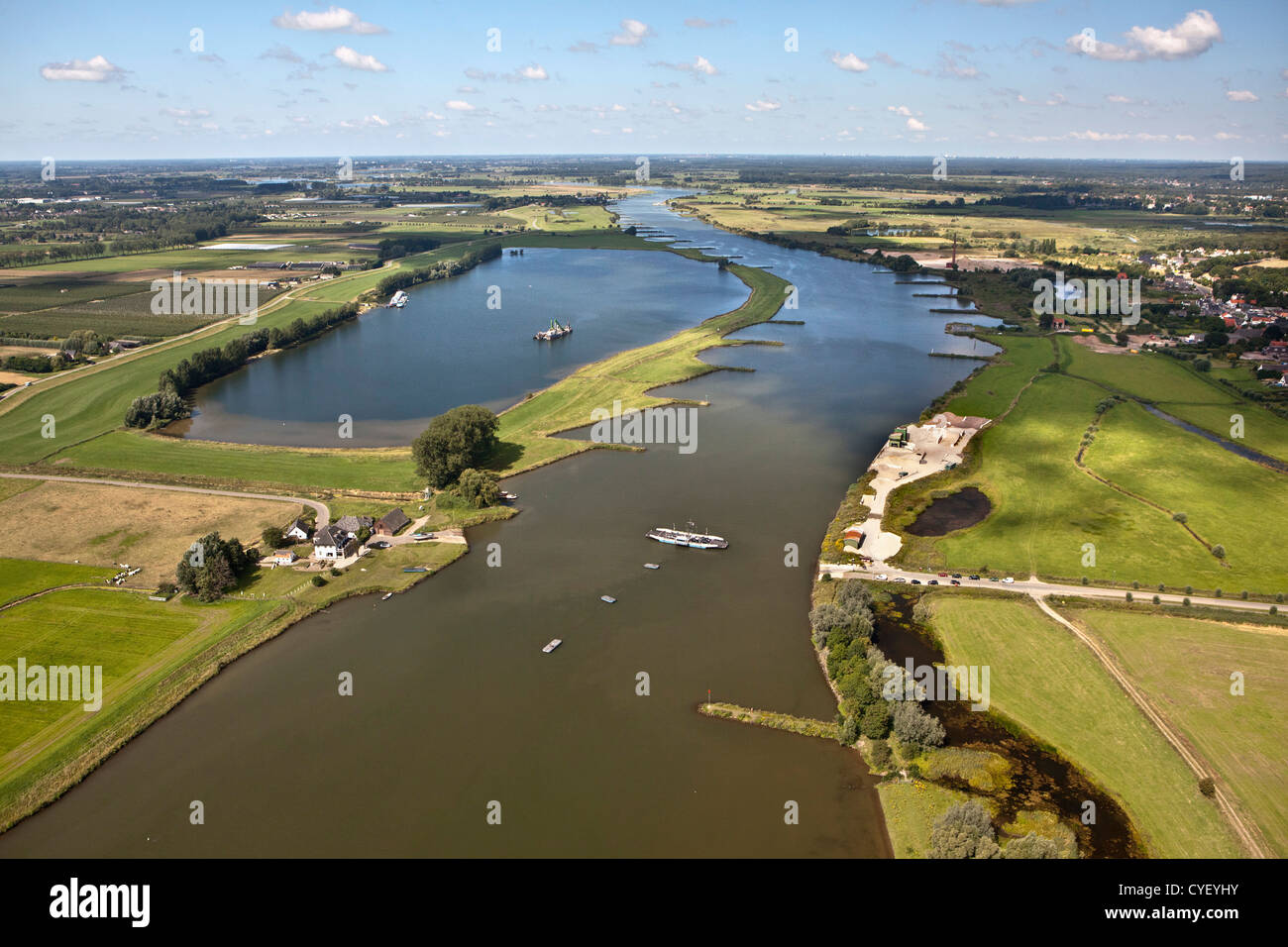The Netherlands, Eck en Wiel, Ferry crossing Rhine river. Aerial. - Stock Image