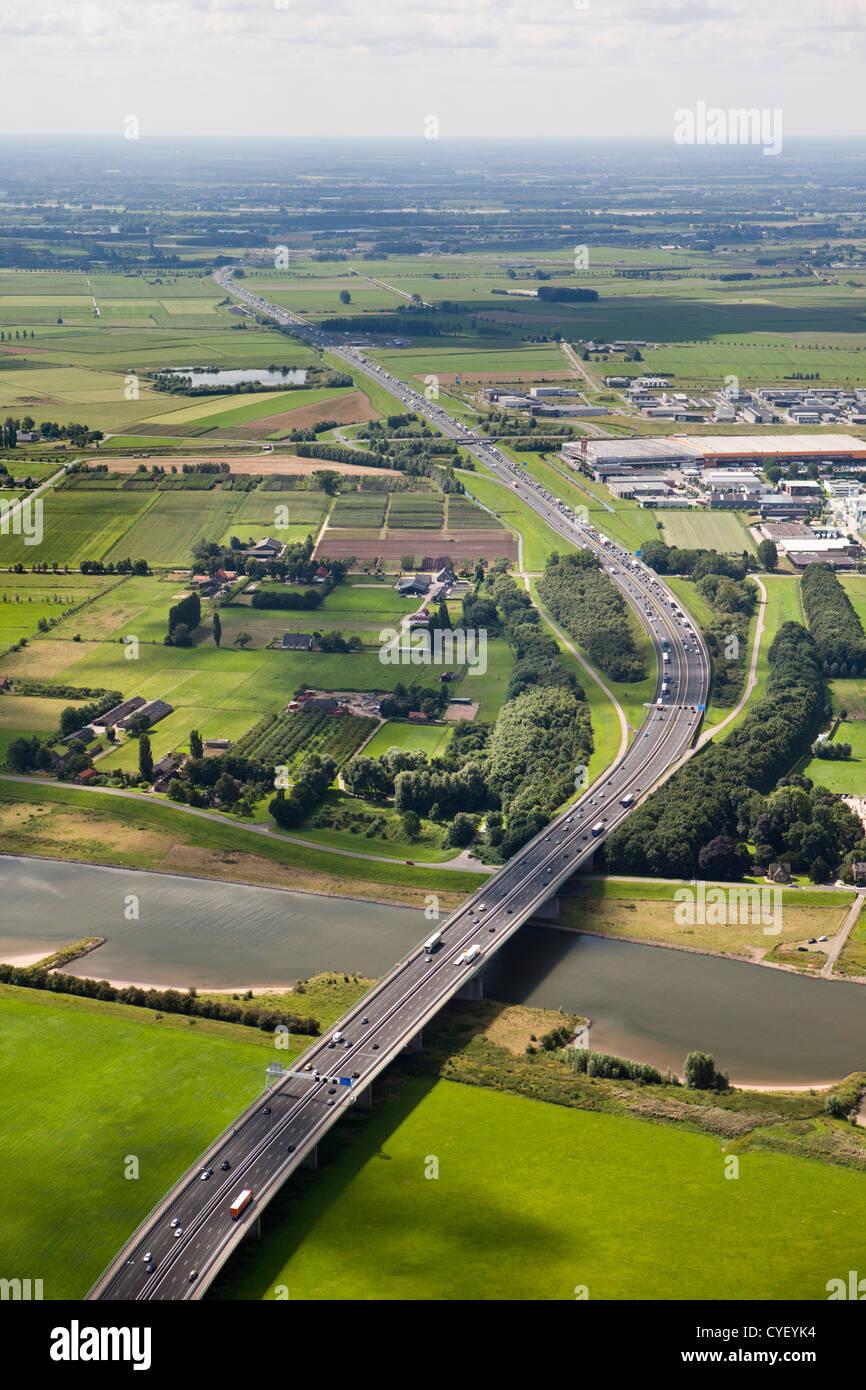 The Netherlands, Beuningen, Highway A50 crossing river Rhine. Aerial. - Stock Image