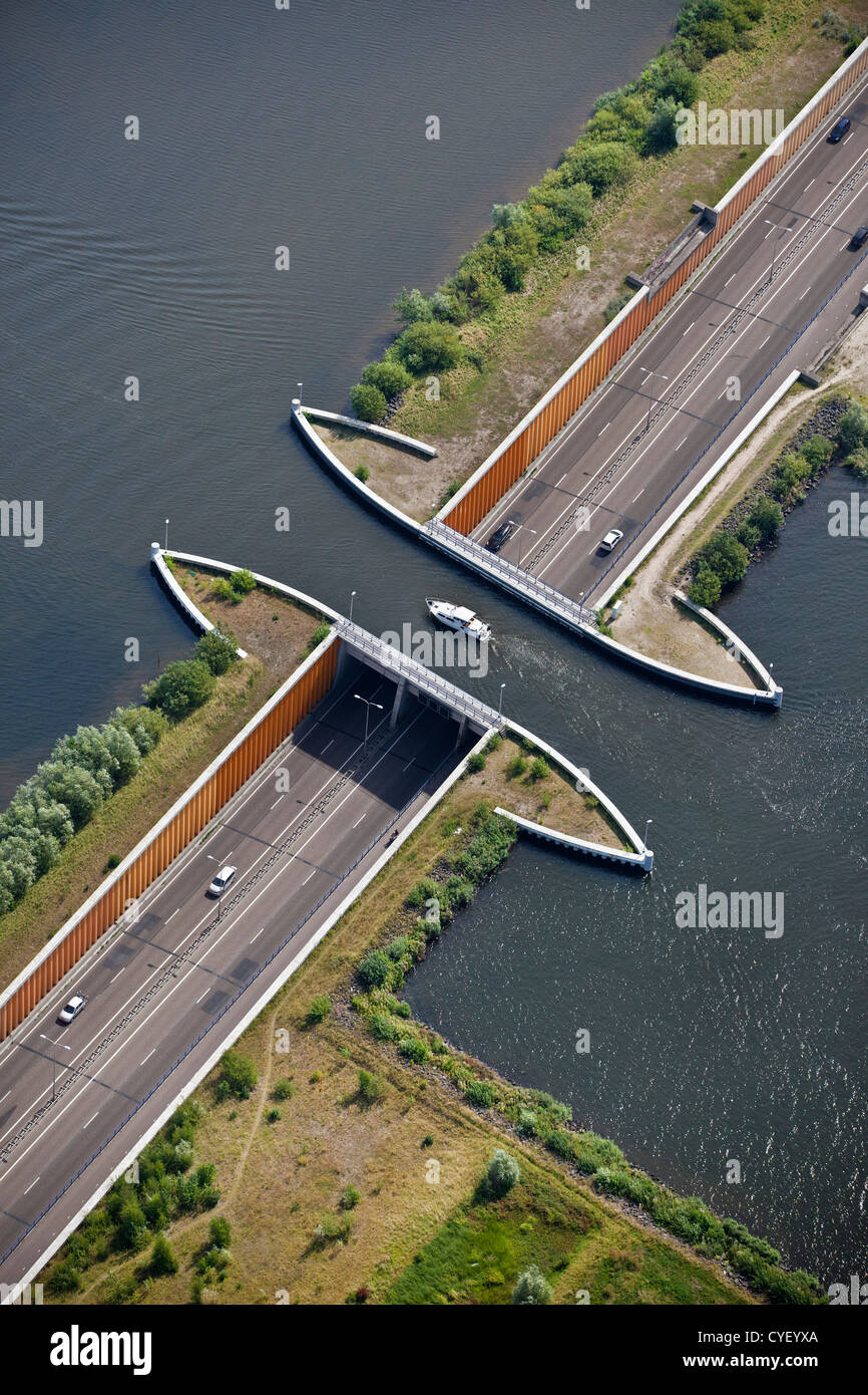The Netherlands, Harderwijk. Small yacht passing aquaduct. Aerial. - Stock Image