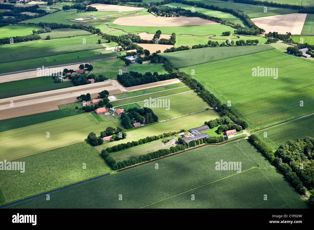 The Netherlands, Stadskanaal. Farms and farmland. Aerial. - Stock Image