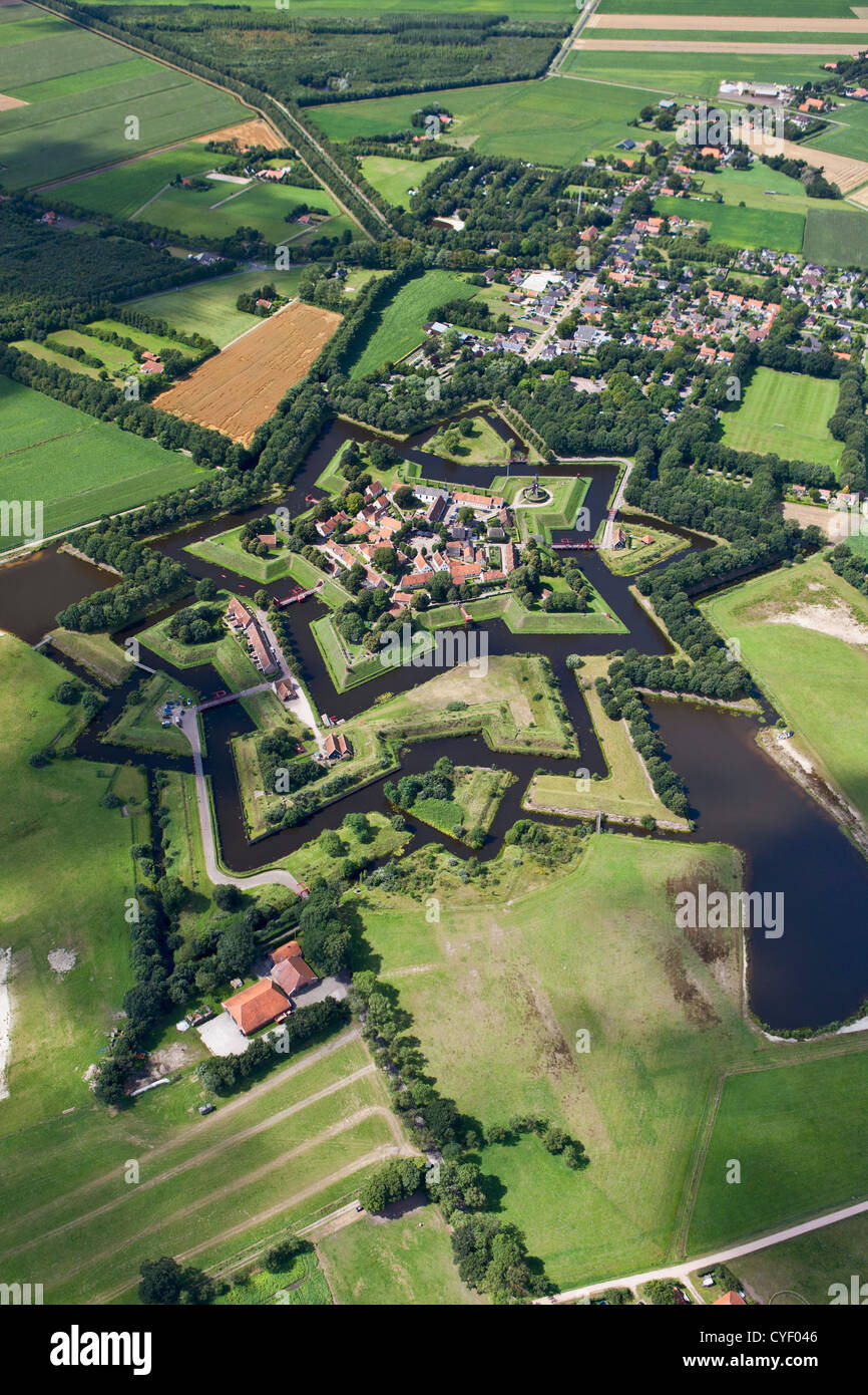 The Netherlands, Vlagtwedde. The fortified, star shaped village of Fort Bourtange. Aerial. Stock Photo