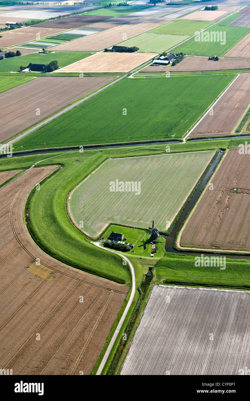 The Netherlands, Eemsmond, Farms and farmland. Traditional windmill called Goliath. Aerial. - Stock Image