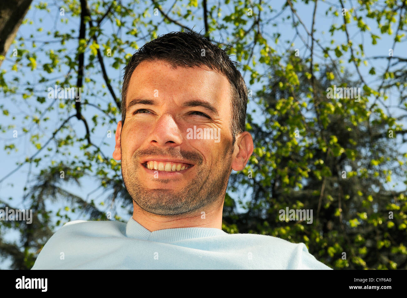 An attractive and cheerful man in sping time - Stock Image