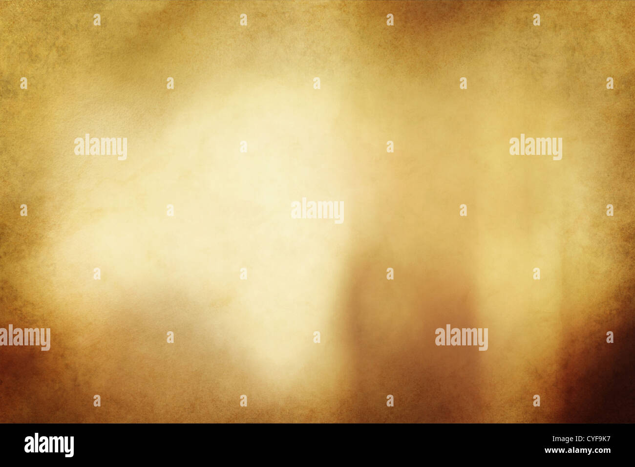 An eerie golden bronze colored grunge texture or background with space for text or image. - Stock Image