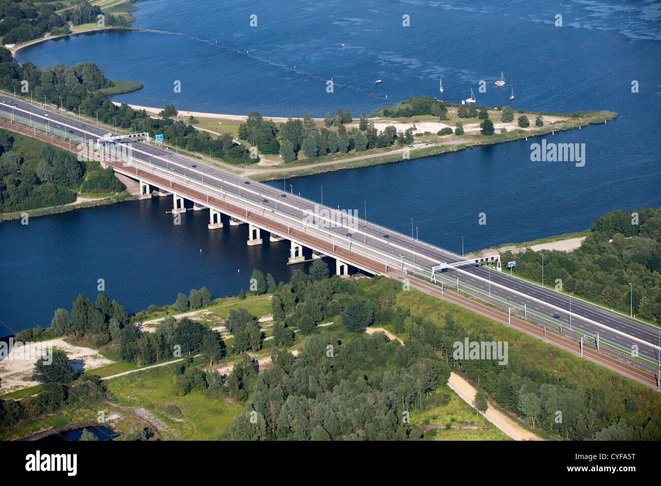 The Netherlands, Muiderberg, Bridge called  Holland Bridge (Hollandse Brug) crossing Gooimeer lake. A6 highway. - Stock Image