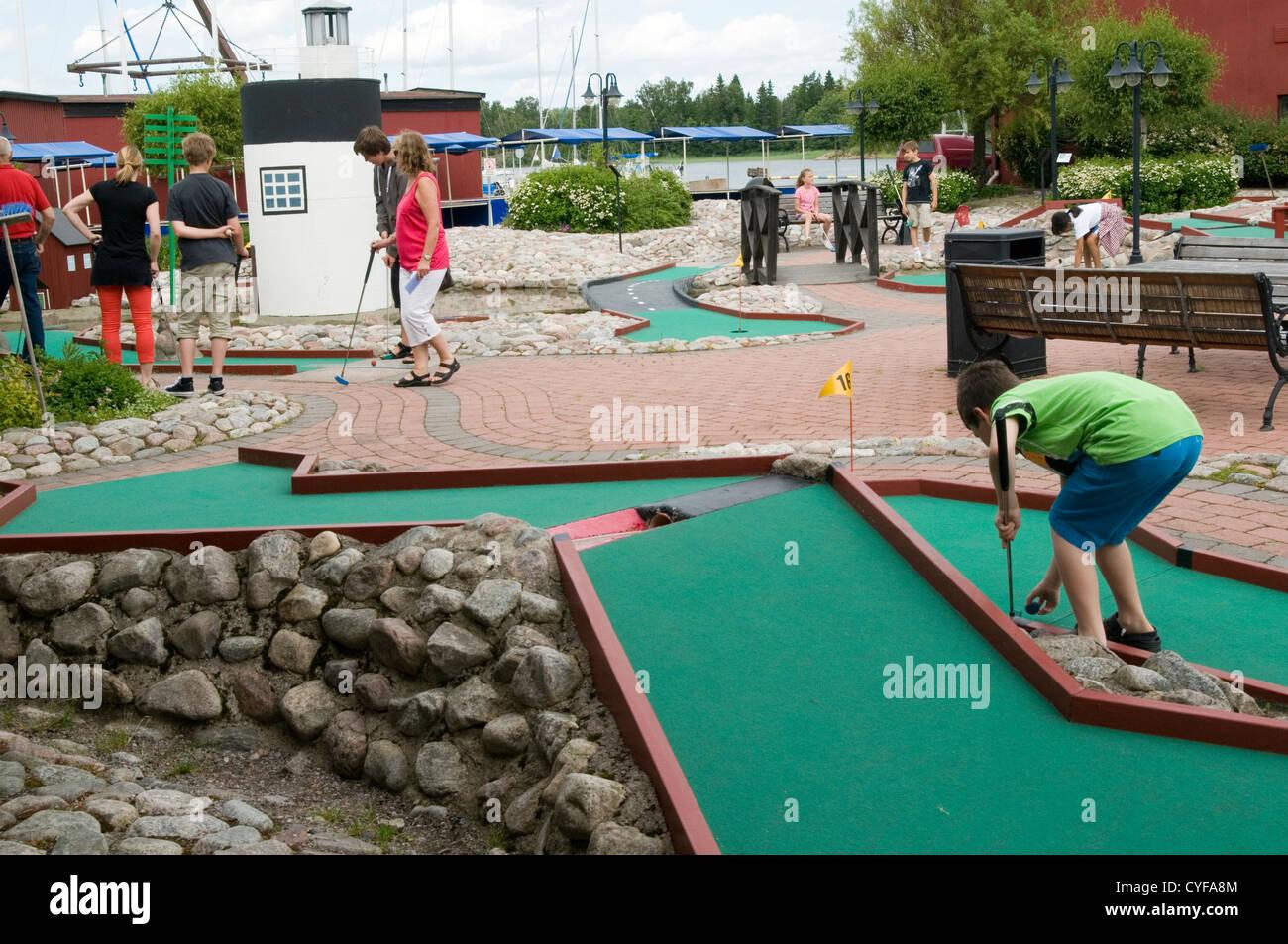mini golf minigolf crazy crazygolf course goofy goofygolf golfer golfers club ball golfball balls - Stock Image
