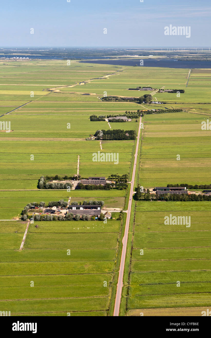 The Netherlands, Bunschoten-Spakenburg, Farms and farmland in Eem polder, Eempolder, and river Eem. Background hamlet - Stock Image