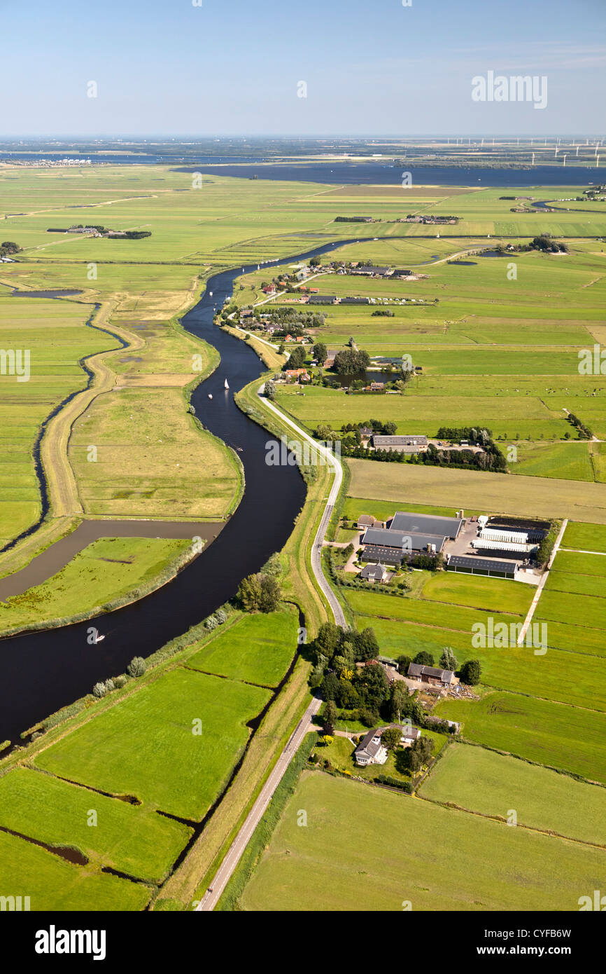 The Netherlands, Bunschoten-Spakenburg, Farms and farmland in Eem polder. Eempolder, and river Eem. Background hamlet - Stock Image