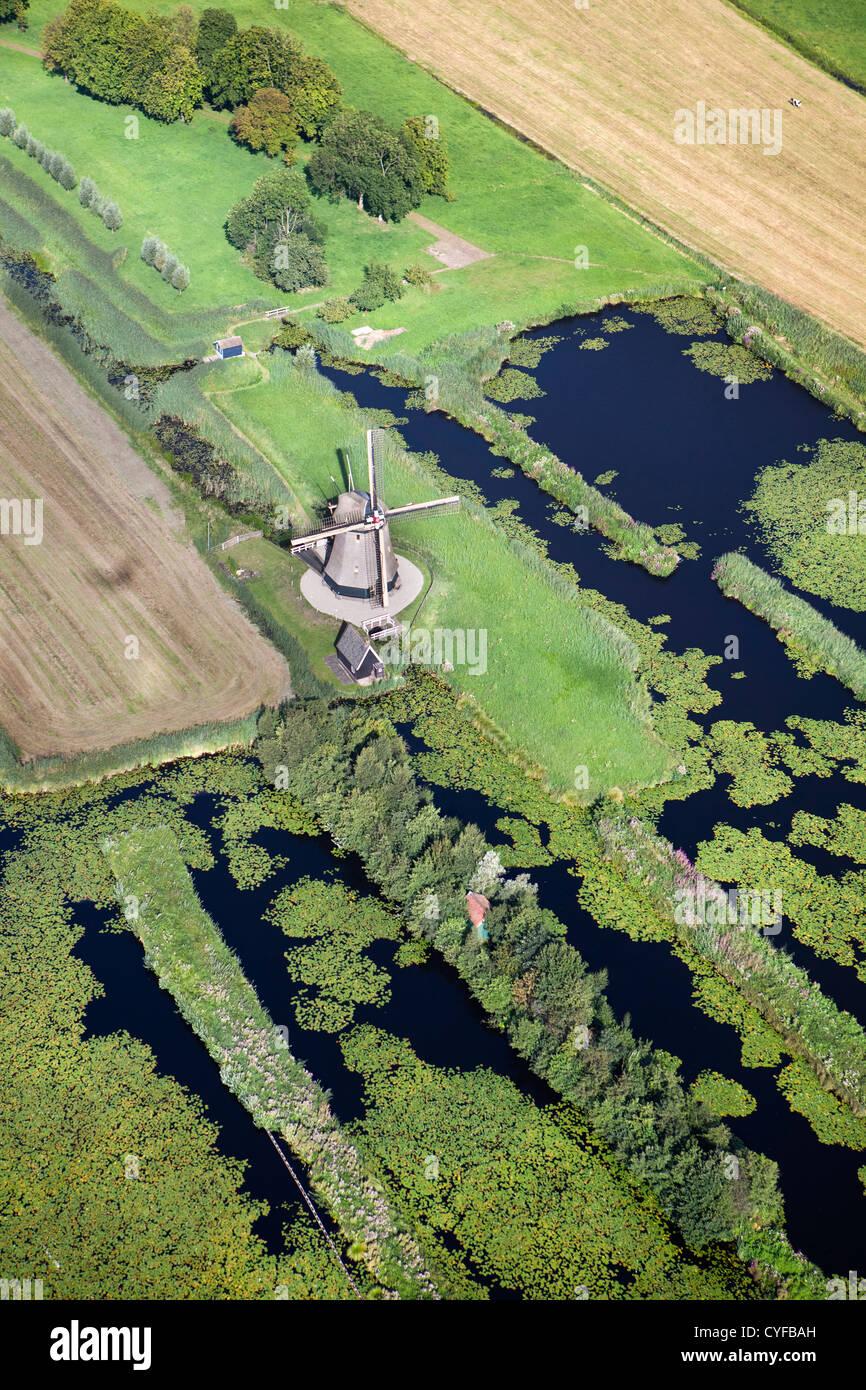 The Netherlands, Loenen aan de Vecht. Windmill in polder. Aerial. - Stock Image
