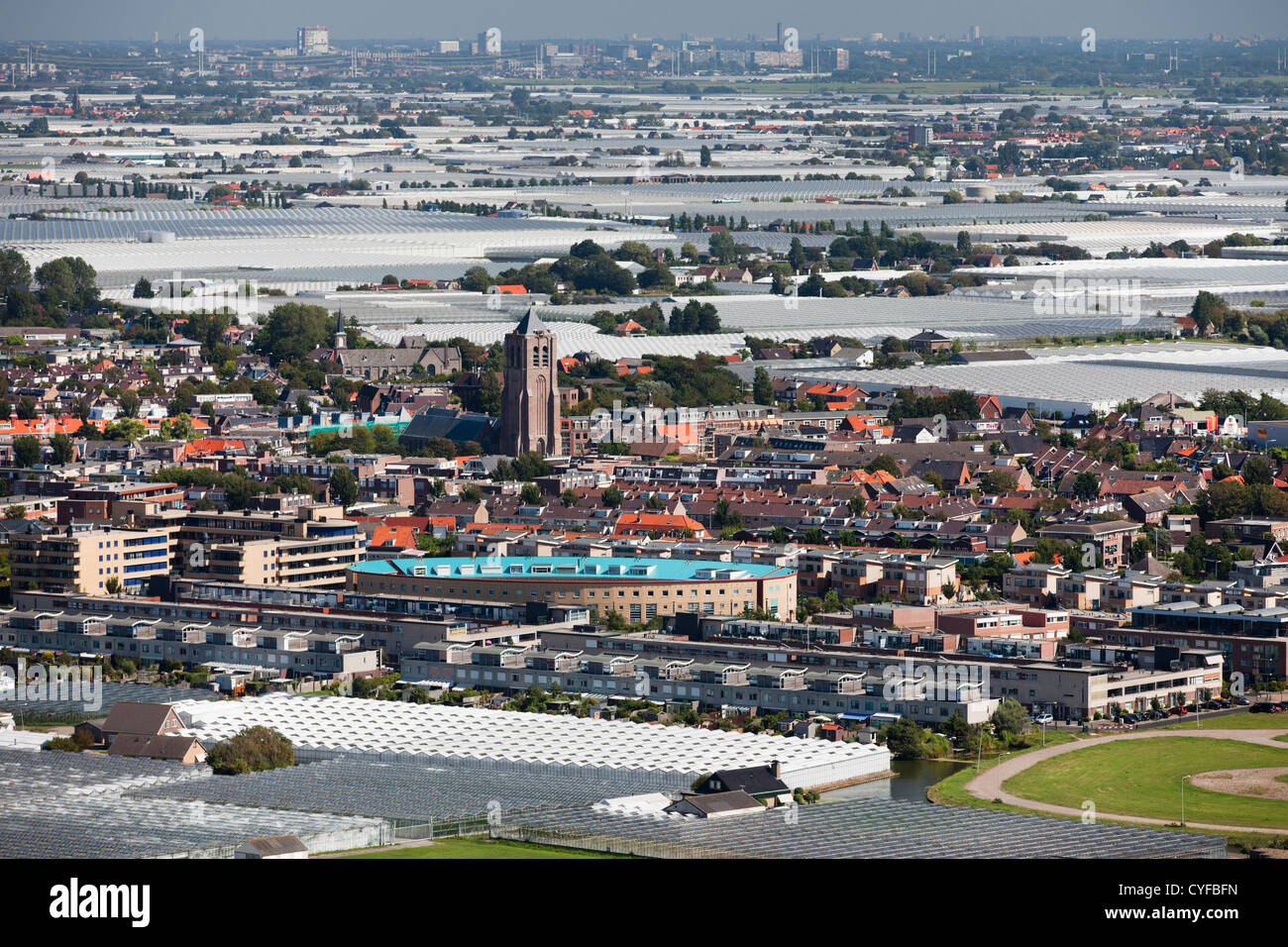 The Netherlands, Monster. View on village and glass houses. Aerial. Stock Photo