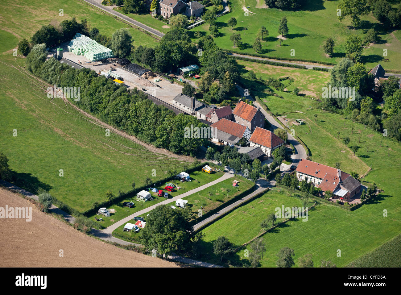 The Netherlands, Epen, Half timbered farmhouses, also campsite. Aerial. - Stock Image